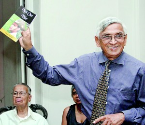 Publisher Vijitha Yapa holds aloft a copy of the new book